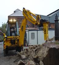 Machine Breaking Ground